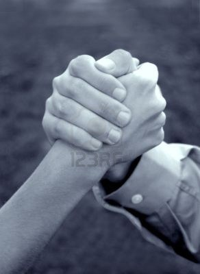456643-hand-of-woman-and-hand-of-man-is-clasped-together-in-symbolic-strength-of-unity
